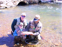 Family Enjoying Fly Fishing Trip